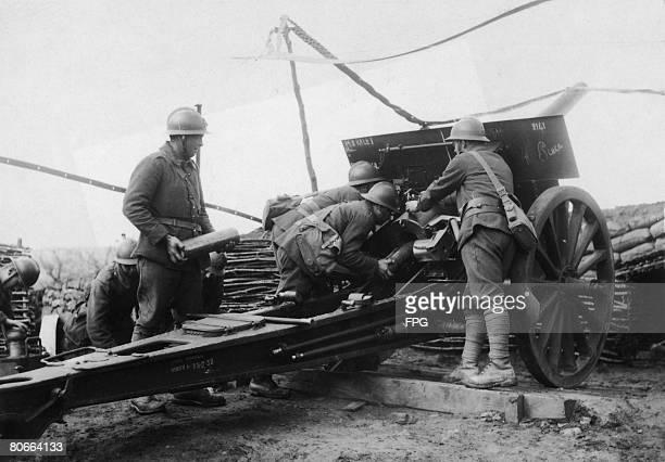 French soldiers loading a 105 mm gun during World War I circa 1916