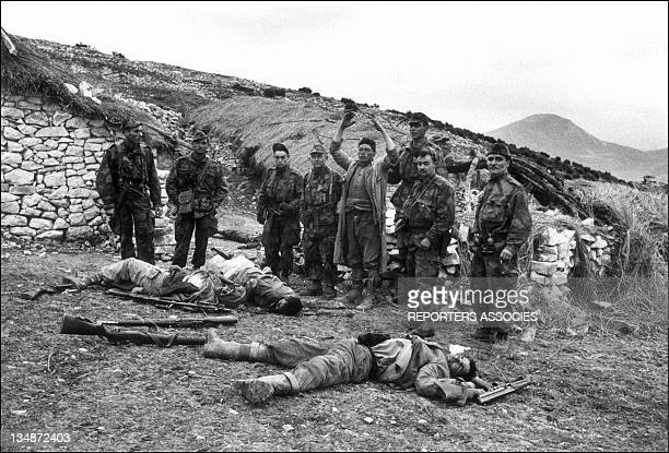 French soldiers looking at dead bodies during 'Operation Bigeard' in March 1956 when an armed outbreak in SoukAhras South of Constantine region...