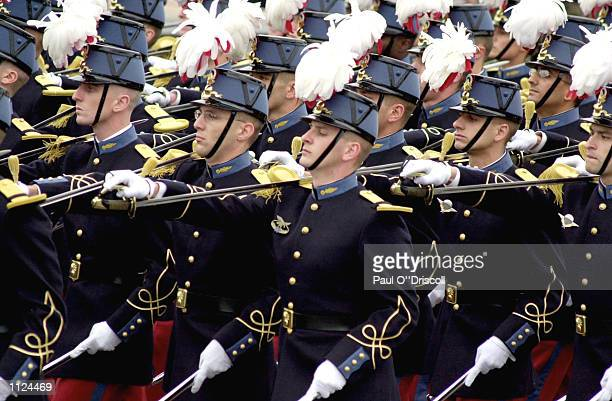 French soldiers march on the Champs Elysees during the Bastille Day military parade July 14 2002 in Paris France The Bastille Day military parade...