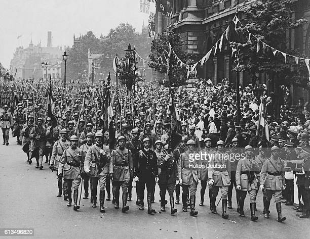 French soldiers marching in a triumphal parade through London celebrating the Allied victory in the First World War Foch and Haig led the...