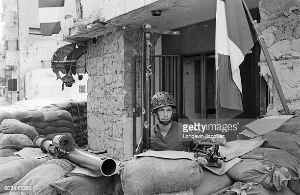 French soldiers, members of the coalition Multinational Force, stand guard in Beirut, Lebanon, as peace negotiations take place at the 1984 National...