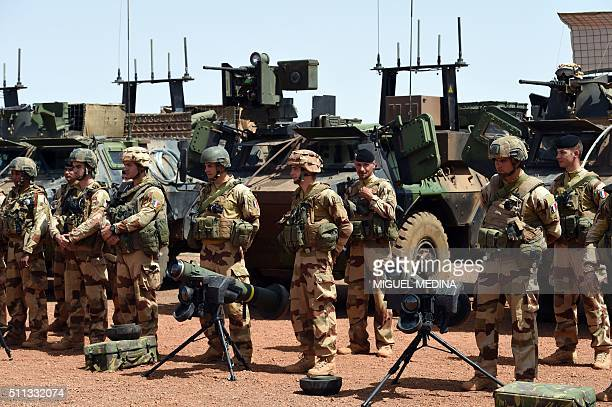 French soldiers of Barkhane counter-terrorism operation in Africa's Sahel region wait for the arrival of France Prime Minister and France Defense...