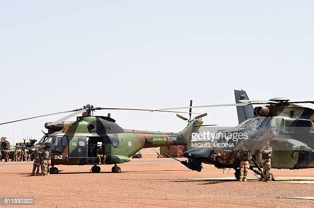 French soldiers of Barkhane counter-terrorism operation in Africa's Sahel region attend France Prime Minister Manuel Valls and France Defense...