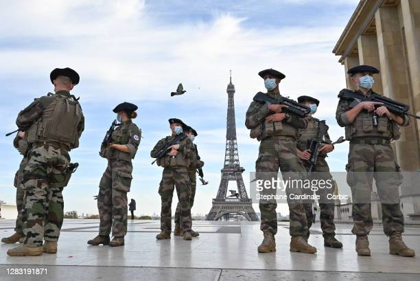 French soldiers of France's anti-terror 'Vigipirate' plan, dubbed 'Operation Sentinelle' patrol at Esplanade du Trocadero in front of the Eiffel...