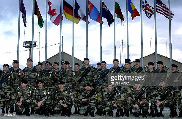 French soldiers of International Security Assistance Force pose for photographers during a ceremony marking their service training of the Afghan...