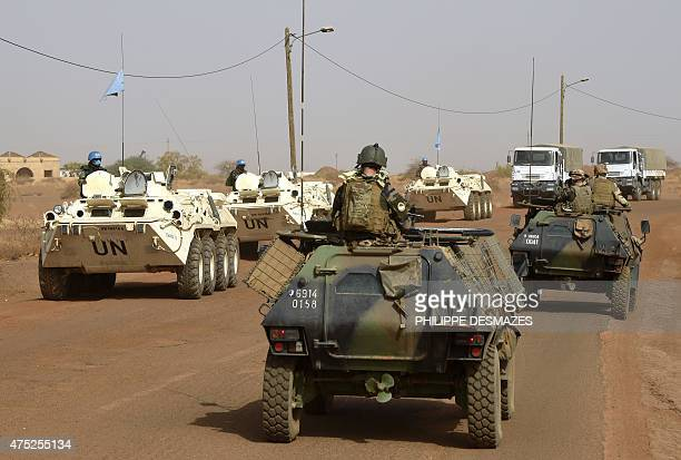 French soldiers of Operation Barkhane an antiterrorist operation in the Sahel patrol with UN soldiers in armoured vehicles on the road between the...