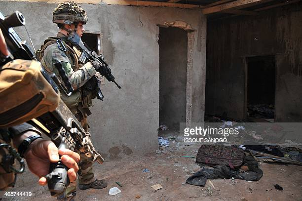 French soldiers of Operation Sangaris patrol in Bangui on January 29, 2014. Gunfire erupted on January 29 in Bangui, still plagued by looting despite...
