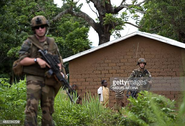 French soldiers of the 13th Alpine Hunters Battalion patrol near the northwestern city of Boda on April 7 2014 Thousands of people have been killed...