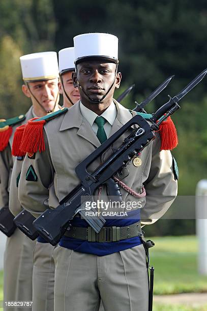 French soldiers of the 4th regiment of the Foreign Legion stand on October 25 2013 at the Bel Air farm near the southwestern French town of...
