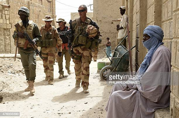 French soldiers of the 93rd Mountain Artillery Regiment and soldiers of the Malian Armed Forces patrol on June 6 2015 in Timbuktu during the joint...