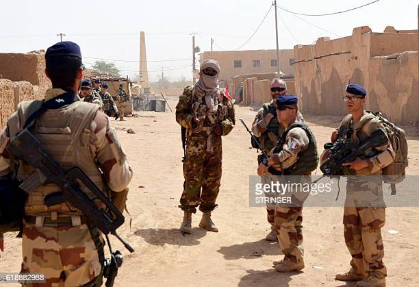 French soldiers of the Barkhane counter terrorism operation and former Tuareg rebels of the Coordination of Azawad Movements patrol in a street on...