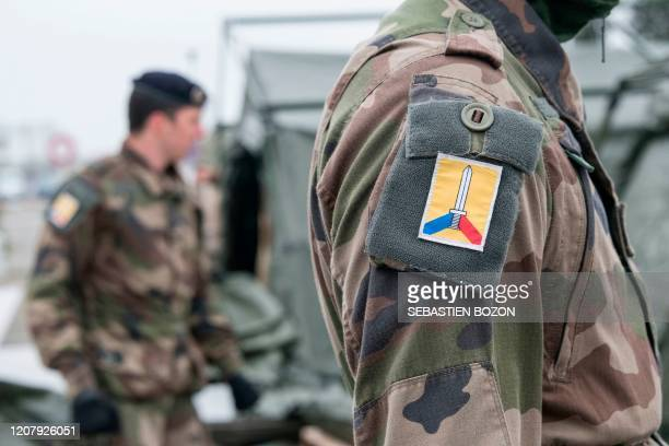 French soldiers of the COMLOG take part in the setting up of a military field hospital at the Emile Muller Hospital in Mulhouse, eastern France, on...