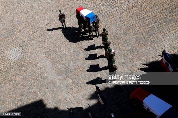 French soldiers of the Commando Hubert carry the French flagdrapped coffins of late special forces soldiers Cedric de Pierrepont and Alain...