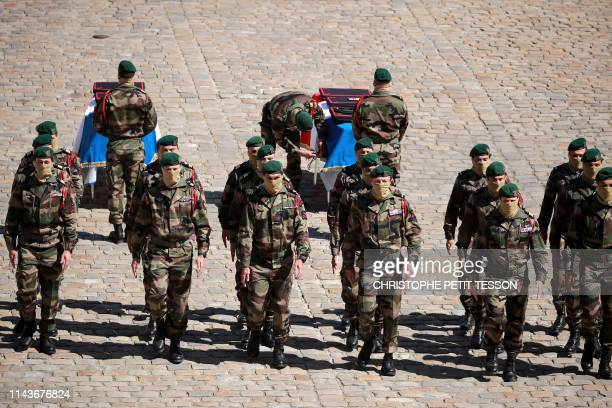 French soldiers of the Commando Hubert pay a last tribute in front of the coffins of late special forces soldiers Cedric de Pierrepont and Alain...