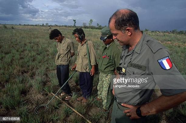 French soldiers of the Foreign Legion intervening through a United Nations mandate teach mine clearing techniques to Cambodian governmental forces...