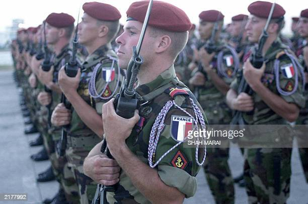 French soldiers of the International Security Assistance Force stand on parade at Kabul International Airport, 13 July 2003, on the eve of Bastille...