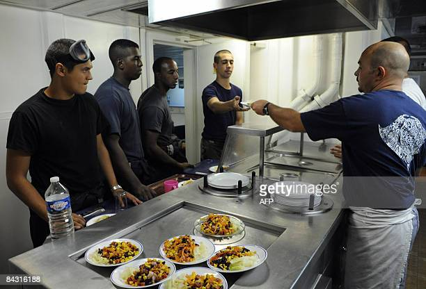 French soldiers of the military French frigate ''Le Floreal'' sailing in the Gulf of Aden prepare food on board the vessel on January 15 2009 The EU...