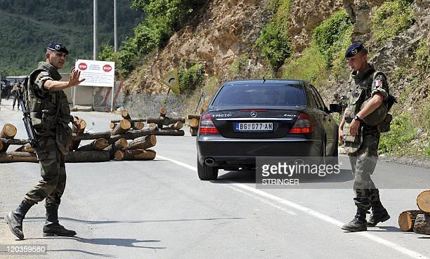 French soldiers of the NATO Kosovo Forces patrol along the Brnjak border crossing in majoritySerb northern Kosovo on August 3 2011 NATO said on...