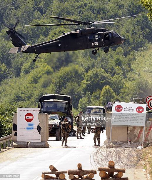 French soldiers of the NATO Kosovo Forces patrol at the Brnjak border crossing in majoritySerb northern Kosovo on August 3 2011 NATO said on August 2...