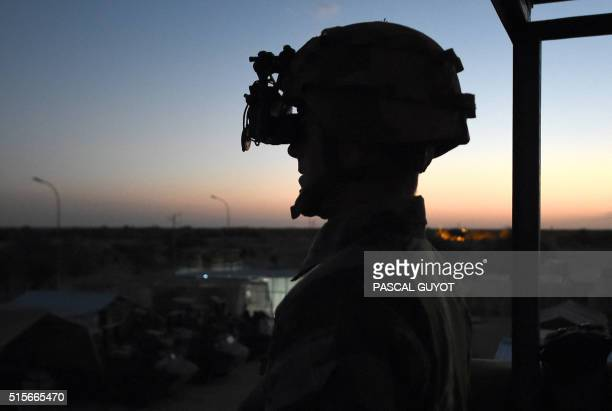 French soldiers of the operation Barkhane an antiinsurgent operation in Sahel equipped with night vision binoculars stands guard on March 8 2016 at...