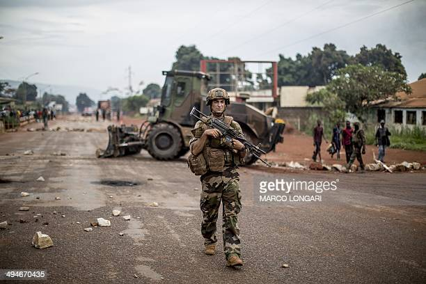 French soldiers of the Sangaris contingent patrol the site of a barricade in central Bangui on May 30 2014 Security forces fired warning shots as...