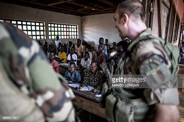 French soldiers of the Sangaris contingent pay a visit to a school in the formerly Muslim PK12 district of Bangui on June 4 2014 France sent troops...