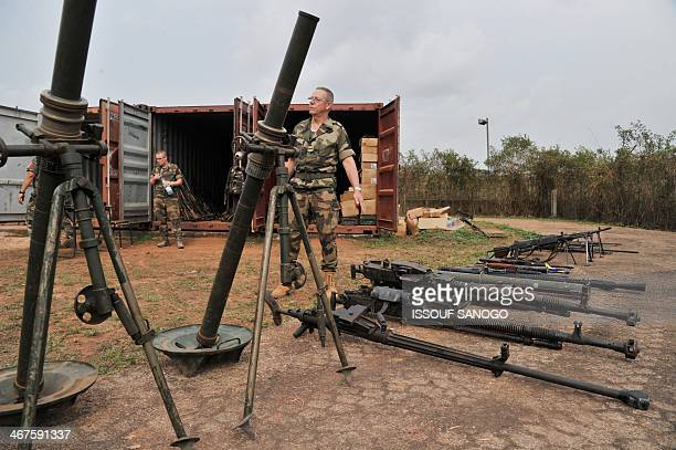 "French soldiers of the Sangaris military operation show to journalists weapons seized from Christian vigilantes known as ""anti-balaka"" and ex-rebels..."