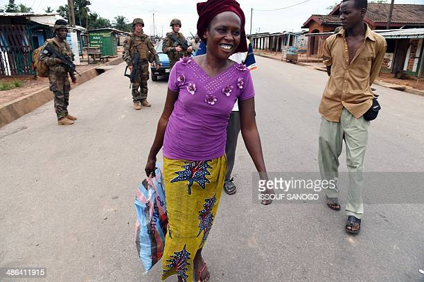 French soldiers of the Sangaris operation look at a Muslim woman they escorted on April 24 2014 after she was attacked by antiBalaka rebels while...