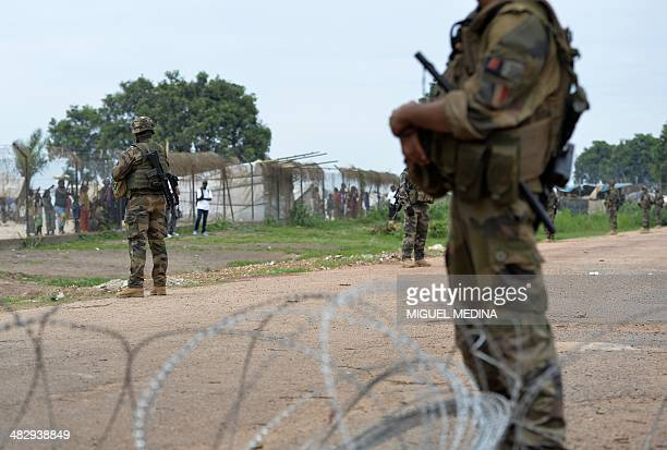 French soldiers of the Sangaris operation secure the airport as UN Secretary-General visits the displaced camp nearby on April 5, 2014. UN...