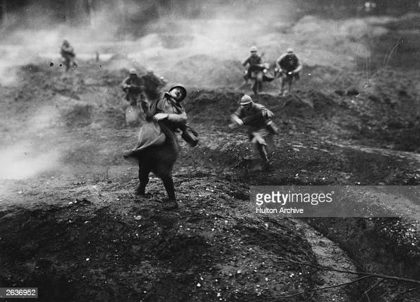 French soldiers on the battlefield, during an offensive action on the French fortress town of Verdun. A still from the 1928 film 'Verdun, Visions...