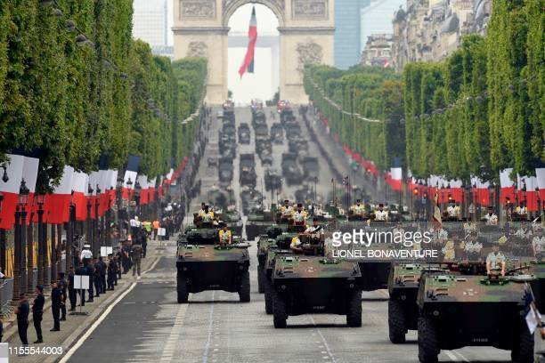French soldiers parade in military vehicles during the Bastille Day military parade down the ChampsElysees avenue in Paris on July 14 2019