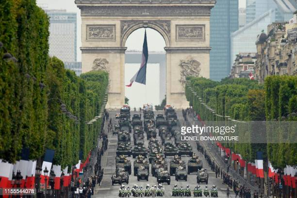 French soldiers parade in military vehicles during the Bastille Day military parade down the Champs-Elysees avenue in Paris on July 14, 2019.