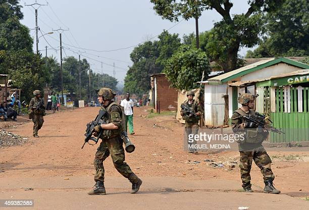 French soldiers part of the operation Sangaris patrol in the Fouh district of Bangui on December 26 2013 The top Catholic and Muslim clerics of the...