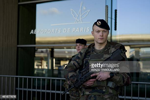 French soldiers patrol at the Charles de Gaulle airport on January 17 2015 in RoissyenFrance north of Paris as part the Vigipirate plan France's...