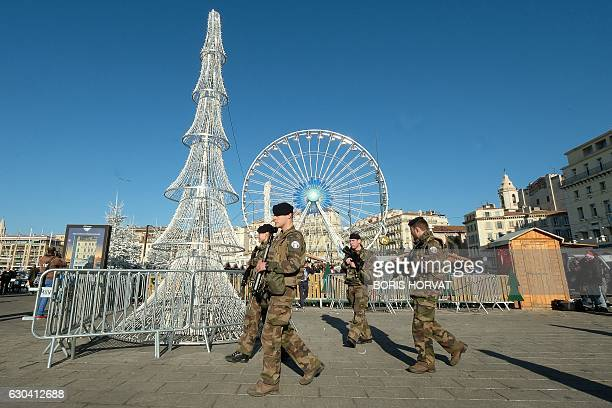 French soldiers patrol at the Christmas market in Marseille on December 22 2016 Security was beefed up at Christmas markets across Europe after a...