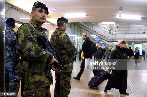 French soldiers patrol at the SNCF railway station La Part-Dieu in Lyon on January 16 after France announced an unprecedented deployment of thousands...