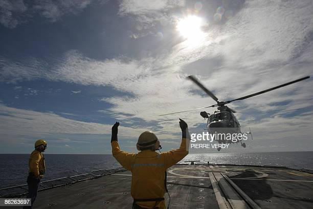 French soldiers perform exercices on the deck of the French warship Le Nivose in front of a Panther helicopter two days after leaving Mombasa harbour...