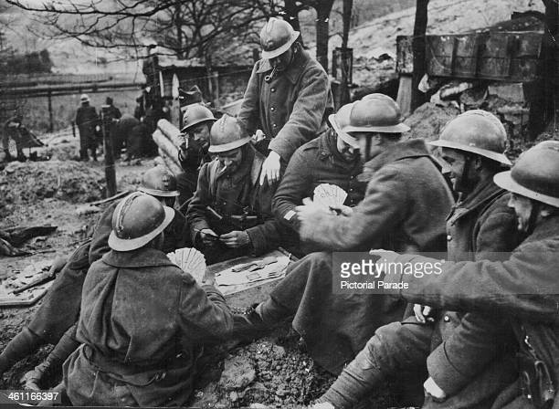 French soldiers playing cards to pass the time on the Maginot Line during World War Two circa 19391945