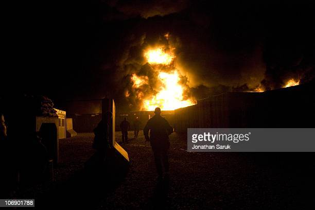 French soldiers run for cover as a major fire at Forward Operating Base Kutschbach that would kill one Afghan employee of the base and destroy a...