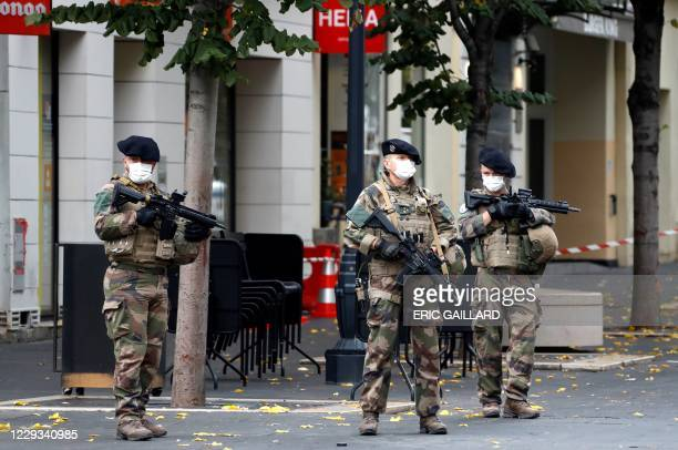 French soldiers secure the Basilica of Notre-Dame de Nice after a knife attack in Nice on October 29, 2020. - France's national anti-terror...