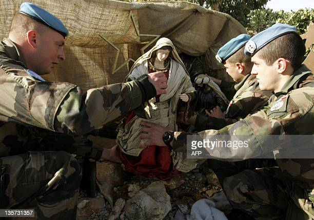 French soldiers serving with the United Nations Interim Force in Lebanon decorate the Nativity Scene at their base in the southern Lebanese village...