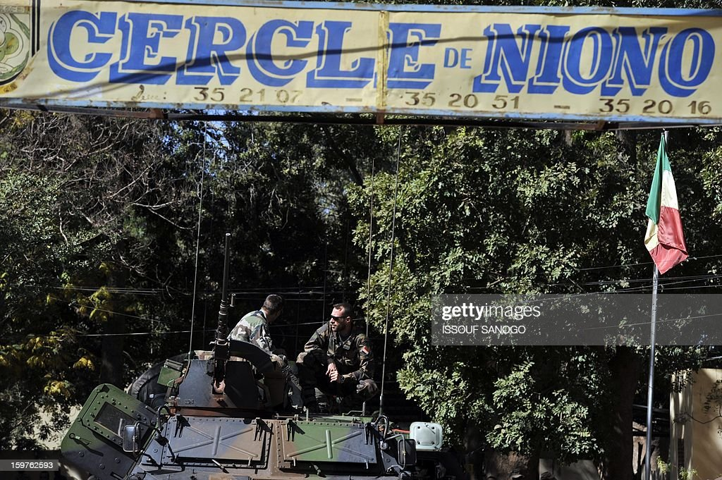 French soldiers sit on a military vehicle on January 20, 2013 in the city of Niono, about 350 kms (220 miles) northeast of the capital Bamako and 60 kms south of Diabaly, which was seized on January 14 by Islamists and then heavily bombed by French warplanes. A spokesman for the French military operation codenamed Serval said on January 20 that French forces were advancing towards Mali's Islamist-held north after taking up positions in the towns of Niono and Sevare. SANOGO