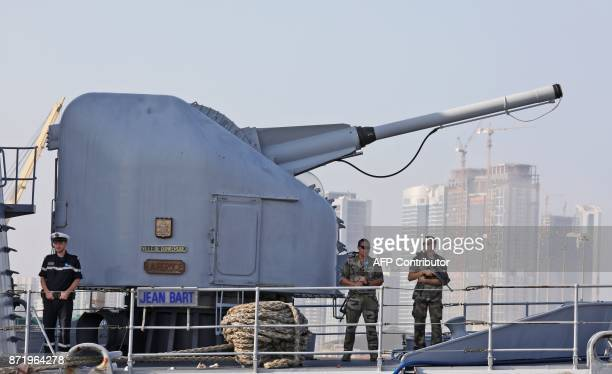 French soldiers stand at warship Jean Bart at a naval base in Abu Dhabi on November 9 2017 during a visit by the French president / AFP PHOTO /...
