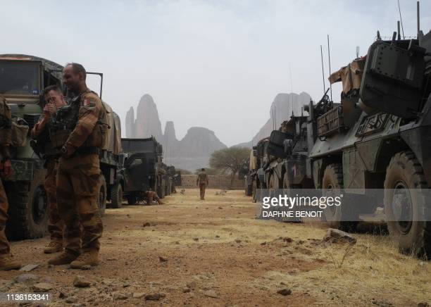French soldiers stand by a convoy of armoured vehicles on March 27, 2019 with the Mount Hombori in the background during the start of the French...