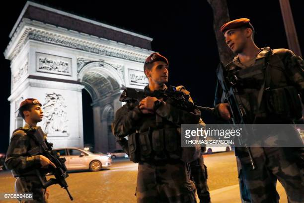 TOPSHOT French soldiers stand guard at the Arc de Triomphe near the Champs Elysees in Paris after a shooting on April 20 2017 One police officer was...