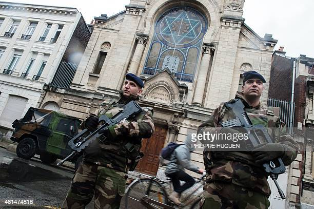 French soldiers stand guard in front of the entrance of a synagogue in Lille northern France on January 13 2015 France announced on January 12 the...