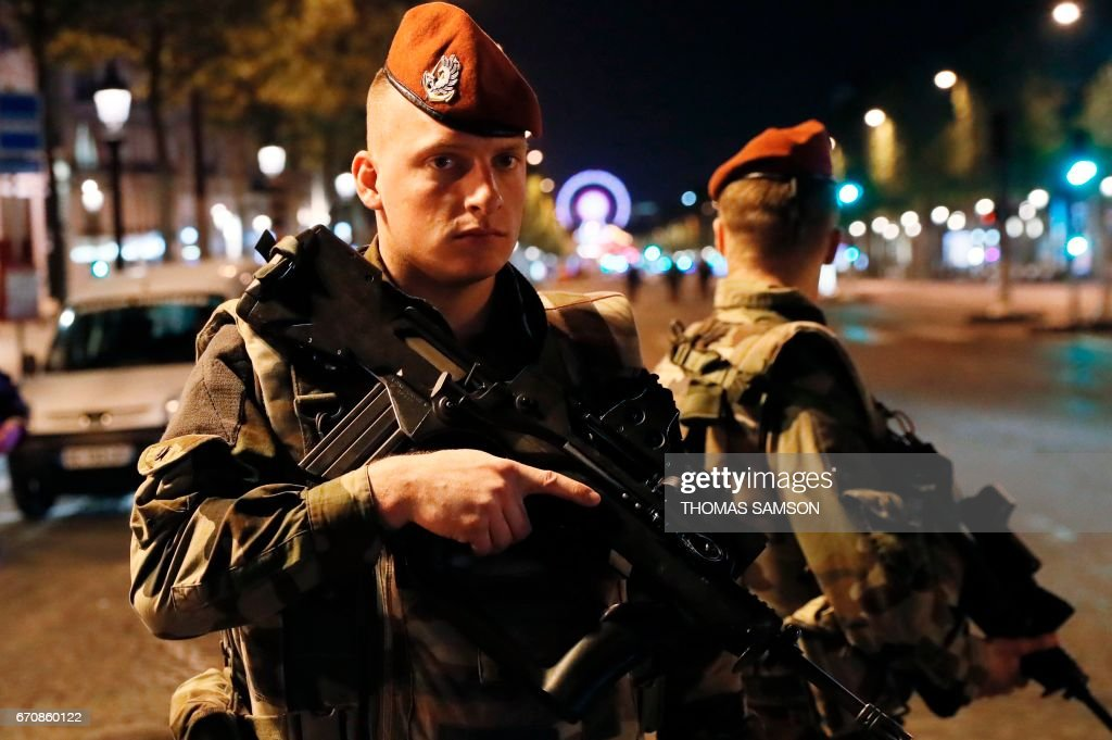 French soldiers stand guard on the Champs Elysees in Paris after a shooting on April 20, 2017. One police officer was killed and another wounded today in a shooting on Paris's Champs Elysees, police said just days ahead of France's presidential election. France's interior ministry said the attacker was killed in the incident on the world famous boulevard that is popular with tourists. SAMSON