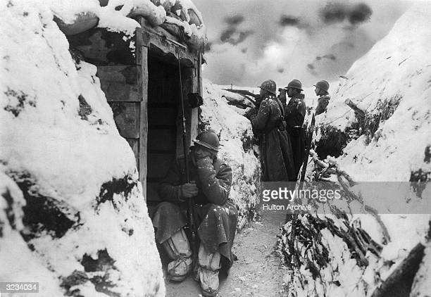 French soldiers stand in a listening post in advance of the firing line in a trench on the Western Front