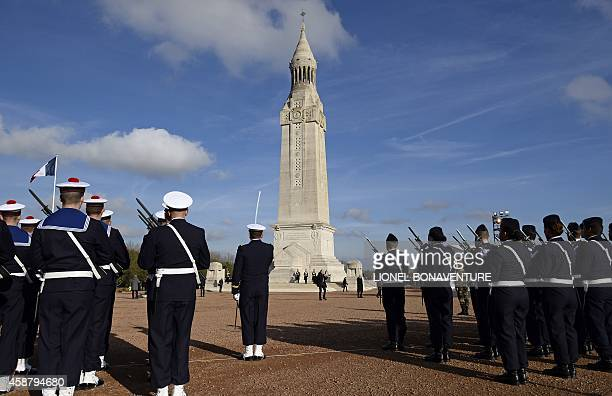 French soldiers stand in front of the NotreDamedeLorette basilica during a ceremony at the war memorial on November 11 2014 in AblainSaintNazaire...