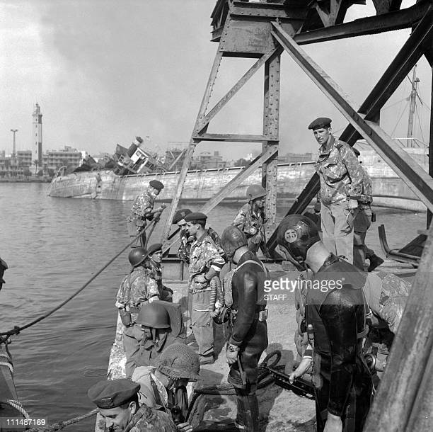French soldiers take part in the re-floating of ships sunk by Egyptians to block Suez Canal, January 1957 in Port Saïd. An Anglo-French intervention...